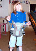 Girl in baby carrier